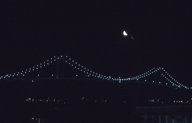 Crescent moon over Newport Bridge.???