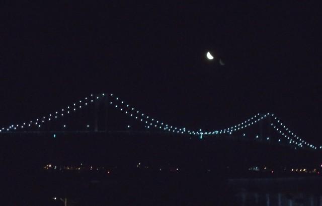 Crescent moon over Newport Bridge.???
